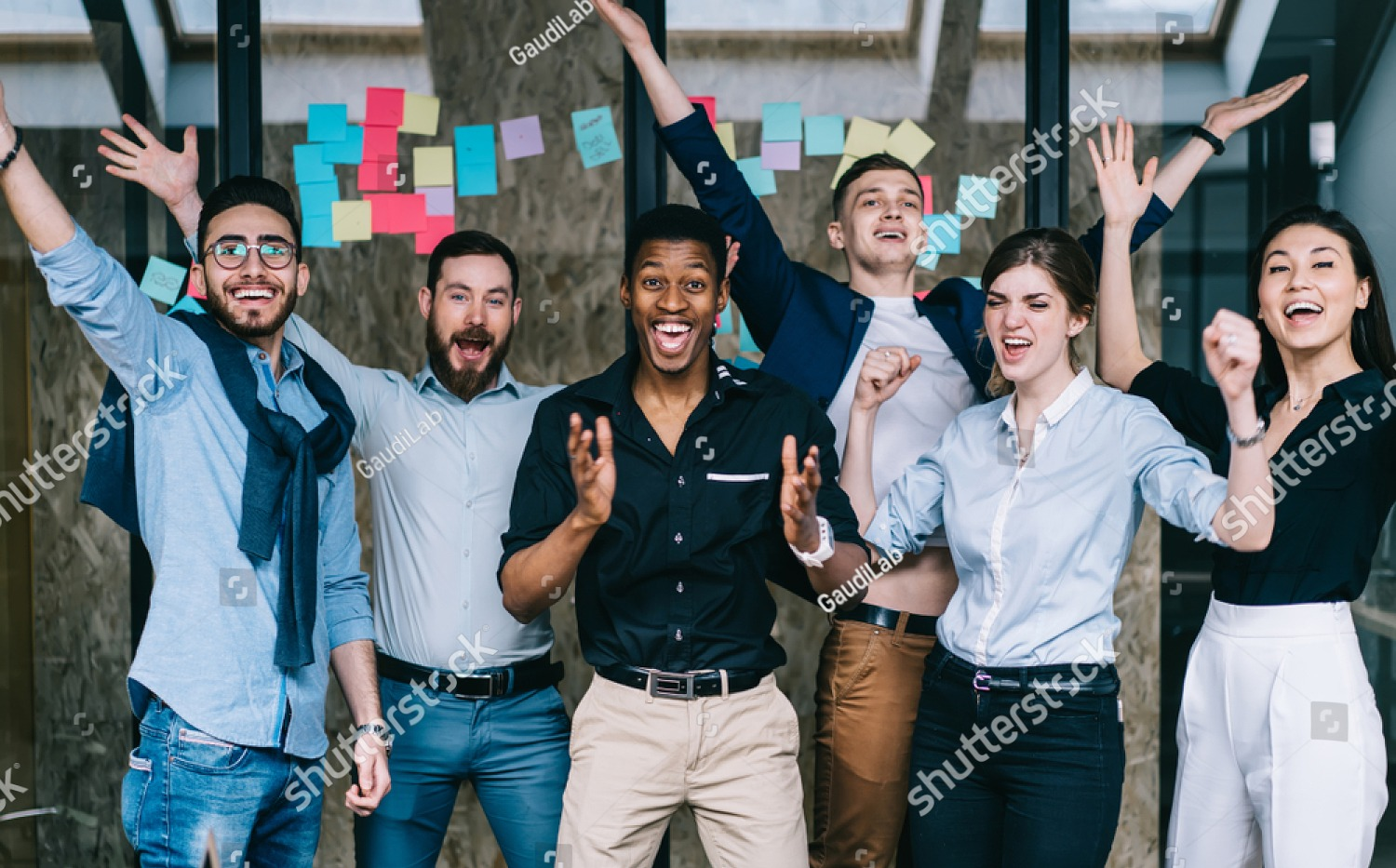 stock-photo-young-crew-of-happy-excited-male-and-female-business-partners-celebrating-completed-startup-project-1388850572